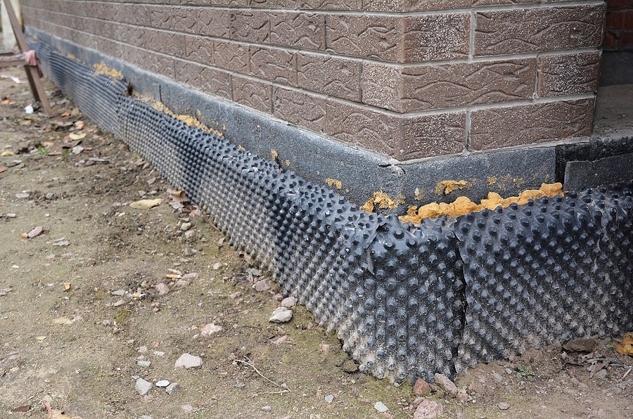foundation insulation with water proofing and damp proofing in problem corner area