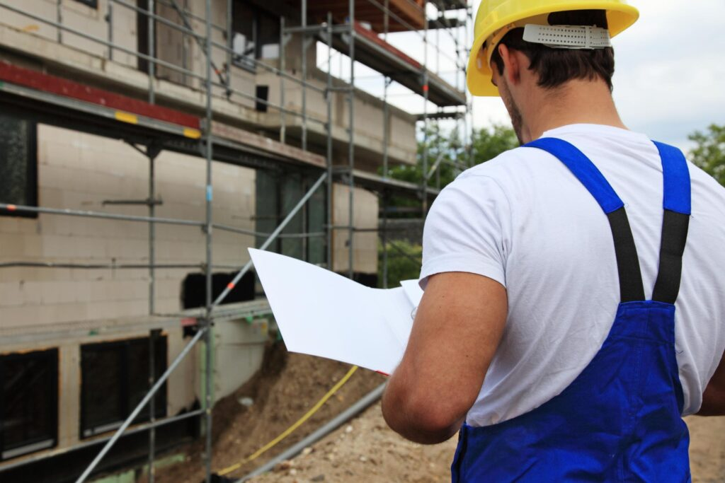 male contractor looking at the plan