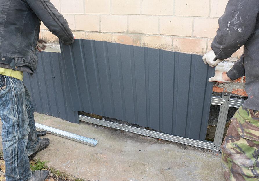 contractors installing metal sheets for waterproofing