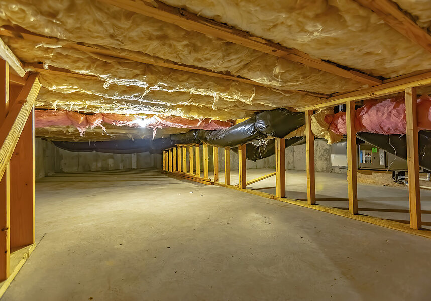 crawl space with upper floor insulation and wooden support beams